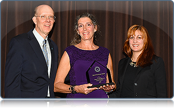 President Carl Strikwerda, Service To Humanity Awardee Tracy Murray '82, and Alumni Council President Elizabeth Romaine '02